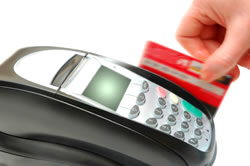 Picture of processing of credit card advance through machine